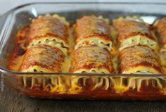 These Mexican Lasagna Roll-Ups have a creamy, cheesy Mexican filling and a spicy tomato sauce. Just 271 calories or 7 Weight Watchers points each! www.emilybites.com #healthy
