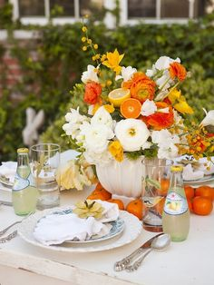 I love the use of citrus here. Again, repetition in the flower arrangement, on the table and the bottled beverage.