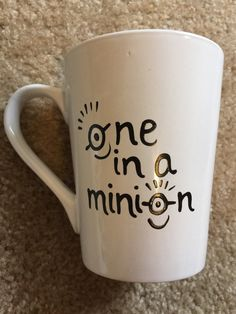 You are... one in a minion! Add your name to the handle of the mug!  Adorable coffee mug. 14 ounces. Hand painted. No sharpies used.  Baked to