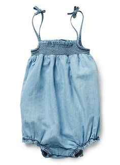 100% Cotton romper. Woven chambray bodysuit in with ruched bodice and tied straps. Snaps on gusset. Regular fit, available in Sky Chambray.