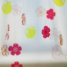 Forever Spring lasercut flowers in neon orange acrylic by Spagat