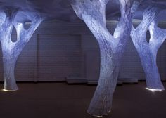 Glowing indoor forest made from paper by Orproject