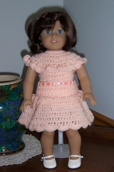 This is a free download from Ravelry: Ruffled Sleeveless Crocheted Sweater & Skirt for 18-inch Dolls pattern by Janice Helge