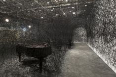 Galerie Daniel Templon - Artist-Chiharu Shiota In Silence (Art Unlimited 2013), 2002-2013 Black wool threads, chairs and burnt grand piano dimensions variables dimensions vary