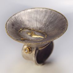 Ring | Christian Streit.  I like this cos it looks like there is a pool of liquid or frozen pool of something inside, cool.