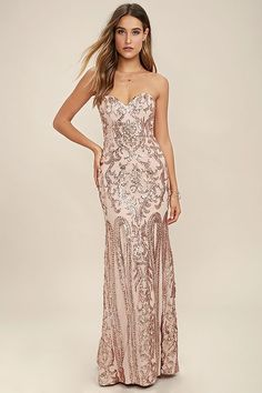 The Bariano Rebecca Rose Gold Strapless Sequin Maxi Dress is sure to make you the belle of the ball! A breathtaking rose gold sequin pattern covers a strapless, sweetheart neckline with princess seams, lightly padded cups, hidden boning and no-slip strips. Fitted bodice gives way to a flaring mermaid maxi skirt. Hidden back zipper and clasp. As Seen On Jessica of Hapa Time blog, Kemper of @joandkemp and Emily of @emilyrosehannon!