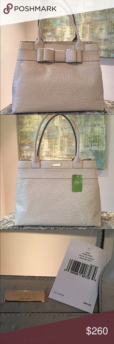 "Kate Spade Tote-Style Large Handbag Authentic Kate Spade Large Handbag - Style: Charm City Ostrich Diehl in Sidewalk (977; photos show true color) - Ostrich-embossed leather with 14-karat gold-plated hardware; Signature KSNY lining - 15.5"" L x 12"" H x 6.5"" W - Handles 8.5"" drop - Open top; footed bottom - Interior features center divider zip pocket; 1 side zip pocket; 2 open slip pockets - Never carried, Original packing paper still inside - Perfect condition except 1 small scratch on…"