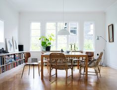 Dining Room: White Walls + Bookshelves + Mixed Wooden Chairs