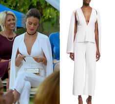 "1x05 Cristal Flores (Nathalie Kelley) wears this white v neck split arm cape jumpsuit in this episode of Dynasty, ""Company Slut"". It is the Cushnie et Ochs Scarlett Woven Jumpsuit."