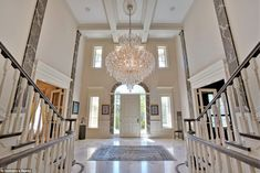Living large: The grand entryway has 20-foot cathedral ceilings and a Juliette balcony ove...