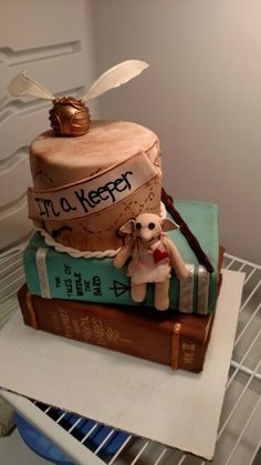 Harry Potter baby shower cake with stuffed Dobby figure.