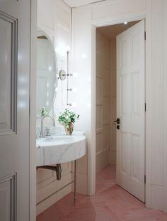 spring-restaurant-london-bathroom-remodelista pink tiled herringbone floor, great light fixtures