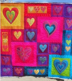 Google Image Result for http://quilting.craftgossip.com/files/2012/01/heart-quilt-267x300.jpg