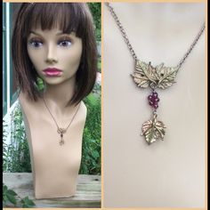 """2 x HP Artisan made grape leaf pendant Essential Style & Total Trendsetter HP Beautiful greenish gold colored grape leaf pendant. Tiny purple beads represent grapes. 16"""" chain with lobster clasp. Don't know what kind of metal this is. This is an art piece. Jewelry Necklaces"""