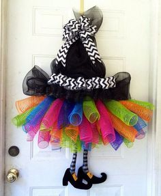 DIY Halloween Wreaths are easy to make and can be made using simple dollar store items. Make your Halloween door decorations special with these easy wreaths Halloween Witch Wreath, Halloween Mesh Wreaths, Fall Wreaths, Fall Halloween, Halloween Crafts, Halloween Decorations, Halloween Witches, Happy Halloween, Halloween Clothes