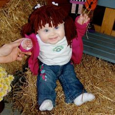 Baby dressed up as a cabbage patch kid... She looks like a REAL doll. #sheshuman