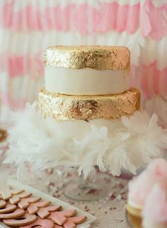 Spa Party: gold foil cake with feather boa // dip dyed feather backdrop //  Styling + Design: Whitepeacock Styled Events - whitepeacockevents.com  Styling + Design: Girl Friday - girlfridaystyling.com    Read More: http://www.stylemepretty.com/living/2013/05/01/watercolor-bridal-shower-from-liz-banfield/