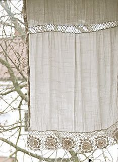pretty curtain - fabric panel for privacy with lacy crochet insert and trim for a little light and decoration.  simple, but not plain