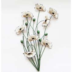A selection of cream poppies and green seeds on a number of green stems. A real eye catching piece of wall art! Sculpture Art, Sculptures, Metal Wall Art Decor, Metal Walls, Contemporary Design, Poppies, Hair Accessories, Wall Hangings, Flowers