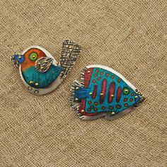 Bird and fish brooches. Colored pencil on copper riveted to sterling silver, sealed with enamel