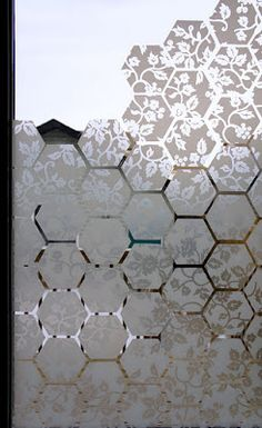 (This is one of my own ideas: making an uneven pattern along the bottom of the windows from window film, but don't like the honeycomb here.) Make your own window film design; do on window between kitchen & storage room