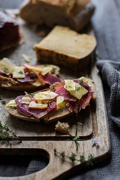 tartines parisiens: ham, comté cheese, fresh thyme on toast drizzled with fine virgin olive oil