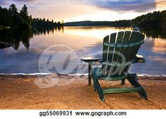 """Wooden chair at sunset on beach"" - Beach Stock Photo from Go Graph"