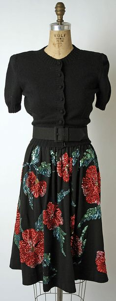 Ensemble (black wool sweater, sequined skirt, and black leather belt), by Norman Norell, American, 1942.