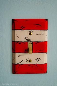 The Dr. Seuss theme custom wall switchplates that I painted myself: The first thing we did in to decorate our baby's Dr. Seuss Truffula Trees Nursery was paint the room! I knew I wanted the room to look have a look of the