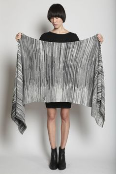 """Lauren Manoogian    Marl Scarf 252.00 USD  Color Charcoal & Oatmeal  Product Details Dry clean. Soft hand-loomed baby alpaca knit scarf with marled effect. Rolled edges.  measure 78"""" x 25"""".  material 100% baby alpaca.  origin Peru"""