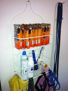 A shower caddy can be hung in all kinds of places -closets or garages or inside doors- to organize and hang things easily AND cheaply (none of that expensive speciality container store stuff). And use them for all kinds of things from pet items like brushes, treats, and leashes to kids outdoor gear or sand toys.