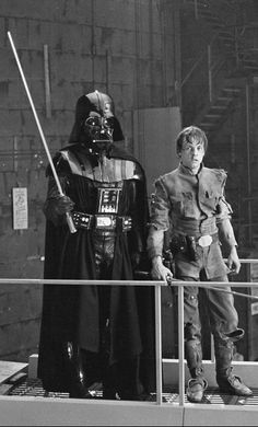 Darth Vader and Luke Skywalker pose while filming The Empire Strikes Back.