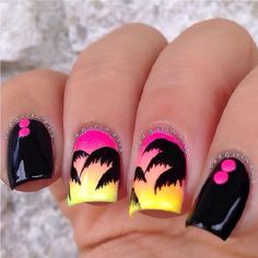 A boldly colored Palm Tree Nail Art design. The nails are in contrasting colors as there are nails in black matte while the other nails have light pink and yellow atmospheres framed by the silhouettes of the palm trees. A truly eye catching nail art design.