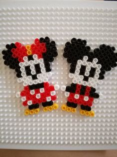 Mickey and Minnie Mouse Perler Bead by MofuruChan on DeviantArtYou can find Hama beads and more on our website.Mickey and Minnie Mouse Perler Bead by MofuruChan on DeviantArt Easy Perler Bead Patterns, Melty Bead Patterns, Perler Bead Templates, Diy Perler Beads, Perler Bead Art, Beading Patterns, Disney Hama Beads Pattern, Pikachu Hama Beads, Color Patterns