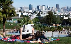 Briana Desch takes advantage of the mid-February heat wave at Dolores Park in San Francisco.
