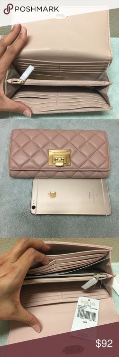 new Michael Kors Astrid leather quilted wallet Brand new. Never used. Never worn. In a perfect condition. Size is 8x5x2. Will fit an iPhone 6 plus easily. With 16 card slots. And many many layers. The color is ballet on the tag. Tag price is $198. The price is firm. Please don't waste your time bargaining. 100% cow leather. Michael Kors Bags Wallets