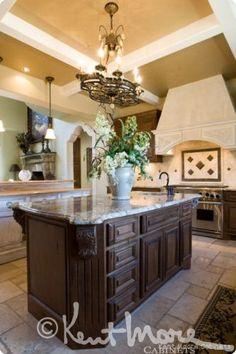 custom island cabinetry by kent moore cabinets rustic alder wood with golden nutmeg ebony glaze. beautiful ideas. Home Design Ideas