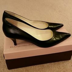 Black Bandolino pumps 2 1/2 inch heels, pointed toes, 3 small scuffs on left heel. We have brick streets where I live. Bandolino Shoes Heels