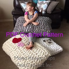 This pattern is simple and easy, using three strands of super bulky Bernat Blanket yarn, your 25mm crochet hook and a few buttons you can whip up this project in a couple of hours. I used inexpensive pillows to stuff them, purchased at a famous big box store for less than $4 each.