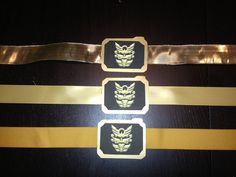 Used gold card stock, sticker paper, hot glue, and various gold ribbon