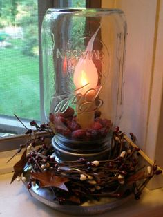Materials: quart mason jar (NOT a big mouth), chick feeder, craft decorative twine/electric candle light with silicone twinkle bulb/E6000 glue/rose hips. Dang it! I had one of these and sold it in a yard sale!