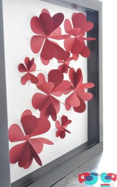 cool 3-D paper flower art for Sis-made this with a flower pattern in 2 colors on preprinted tree shape. Pretty!