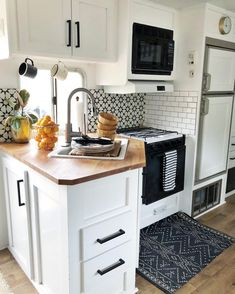 Ashley Petrone of Arrows and Bows transformed a dated RV into a modern tiny home.