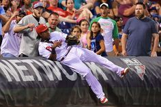 Franco reels one in:     Maikel Franco #7 of the Philadelphia Phillies falls into the tarp after catching a foul ball in the eighth inning against the Washington Nationals at Citizens Bank Park on Aug. 29, in Philadelphia, Penn. The Nationals won 4-0.