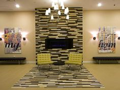 Very modern look with the blue flame and the floor to ceiling tile