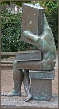 ".""Der Buchhändler"" (The Book Seller) by Michael Schwarze. Ludwig-Metzger-Platz, Darmstadt, Germany. Photograph by Neil Gallop."