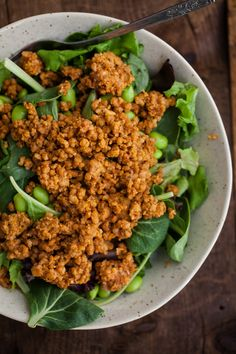 A vegetarian salad that uses pecans, oats, and brown rice to make a crumble and smothered with buffalo sauce.