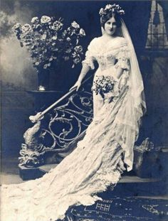 1910s. I like the way the veil sweeps the same direction as the railing.