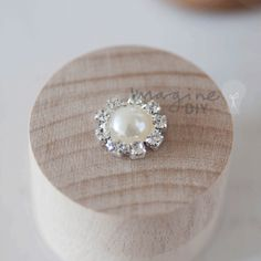 Small round embellishment with pearl centre and crystal border. DIY wedding stationery supplies Decorate your own wedding invitations.