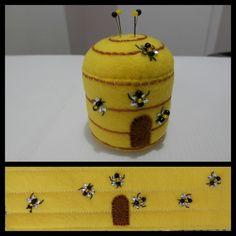 Bee hive pin cushion.